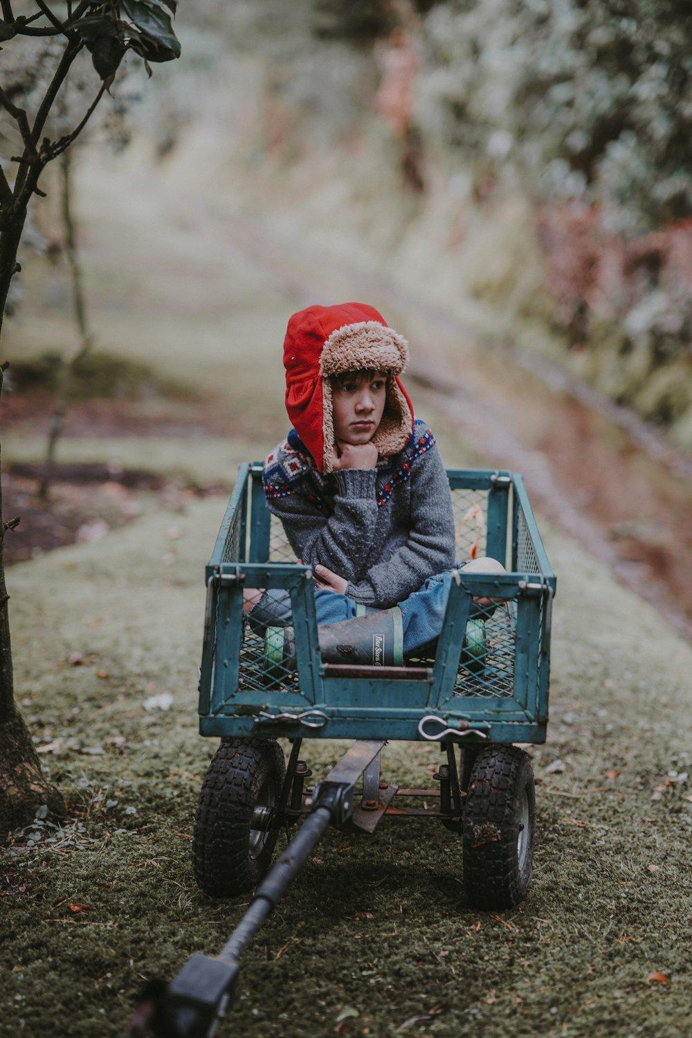 kid thinking in wagon.jpg