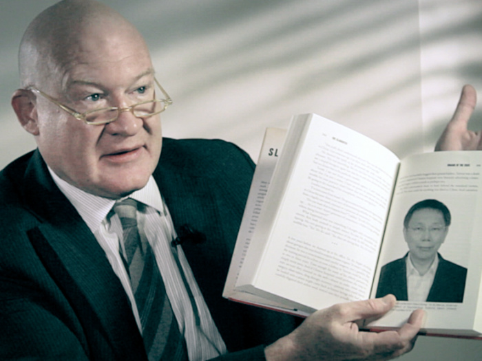 """Ethan Gutmann holds a copy of his book """"The Slaughter."""" (Courtesy of subject)"""