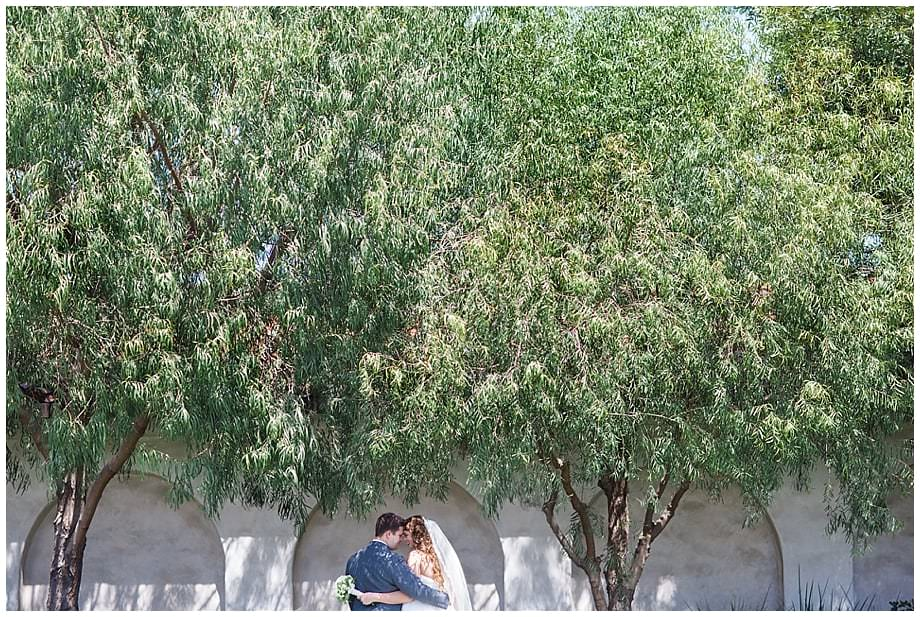 Romantic bridal portraits by the trees at the Old Ranch Country Club