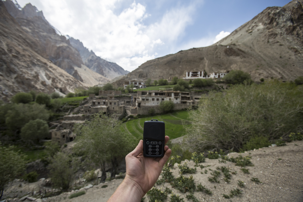 This town in the Ladakh region takes three days to walk to and is inaccessible by car. You can see my hand holding a Mega Voice, a solar-powered device with the New Testament on it.