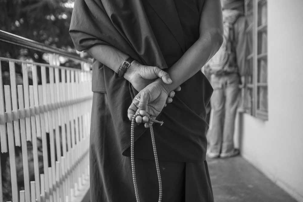 A monk holds prayer beads as he quietly walks around the temple in Dharamsala. This is the Dalai Lama's temple. He was exiled from Tibet when China took over and he came to Dharamsala.