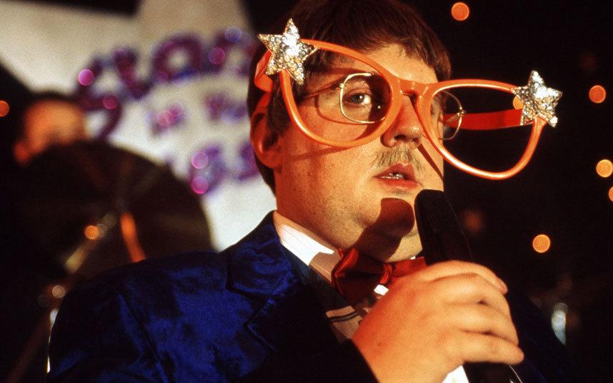 Brian Potter as Elton John.