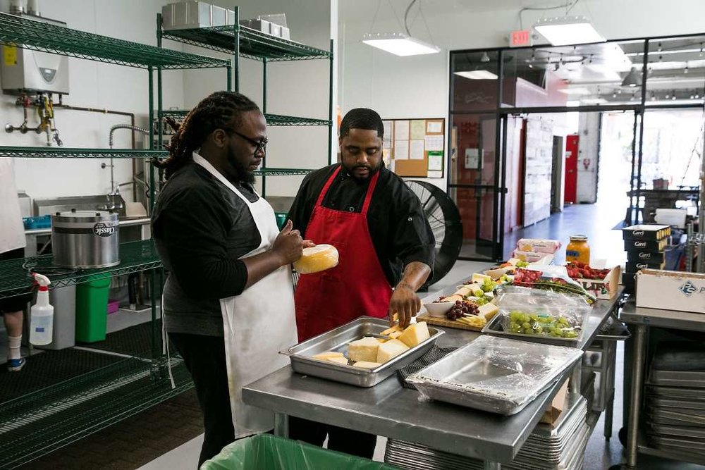 Workers at the  Red Door Catering  headquarters in West Oakland.  Photos by Mason Trinica, courtesy of the San Francisco Chronicle.