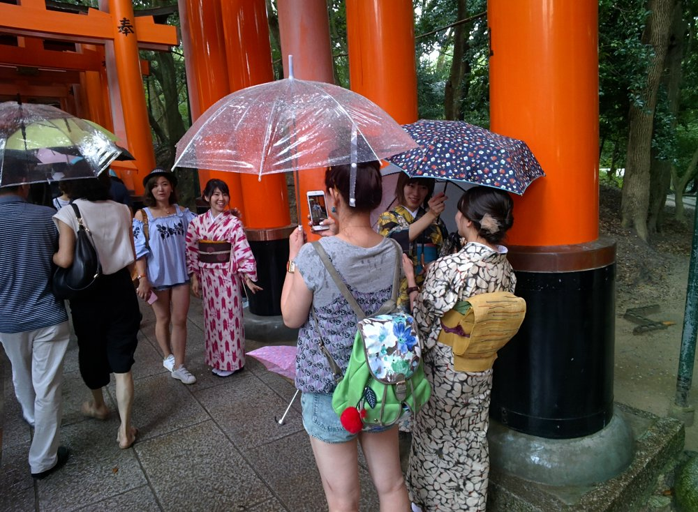 Here are some tourists from China, posing for pictures dressed in traditional japanese clothing.