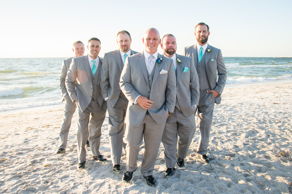 groom and groomsmen pose