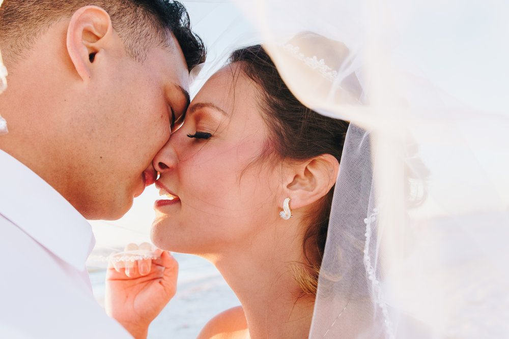 kiss under the veil, beach wedding, bride and groom, St.Pete wedding photographer, St.Pete wedding, St.Pete beach, tide the knot beach weddings, mir salgado photography, Tampa wedding photographer