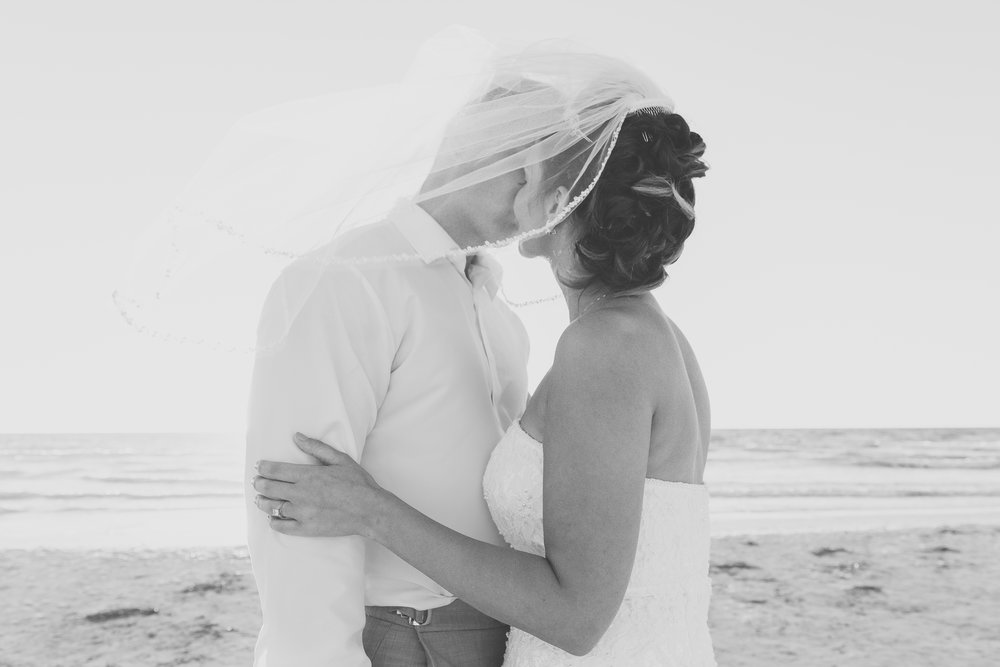 kiss under the veil, beach wedding, bride and groom kiss, St.Pete wedding photographer, St.Pete wedding, St.Pete beach, tide the knot beach weddings, mir salgado photography, Tampa wedding photographer