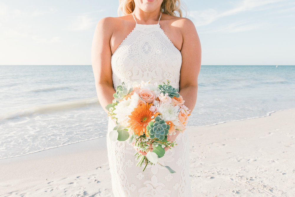 bride-flowers-beach