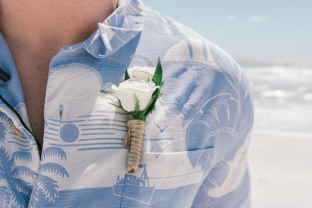 St.Pete-wedding-photo, groom-beach-wedding-bouttonier