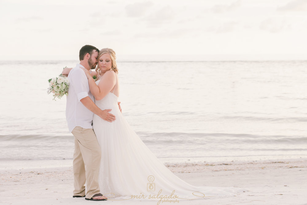 bride-and-groom-beach-wedding-photo. Tampa-wedding-photographer
