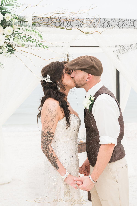 first-kiss, beach-wedding-ceremony, Florida-wedding-photo