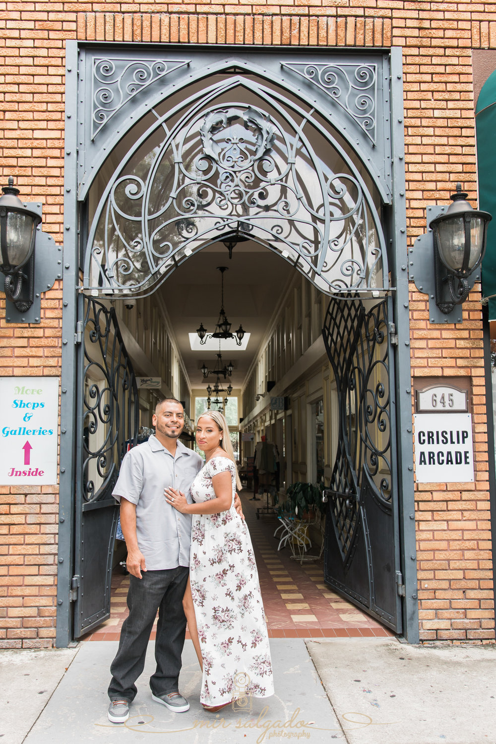 miriam-photography-tampa-st-pete-engagement-session-sunny-floral-dress-shops-galleries-crislip-arcade