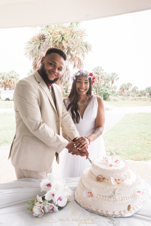 Fort-De-Soto-beach-pictures-flowers-flower-crown-wedding-dress-tan-suit-cake-cutting