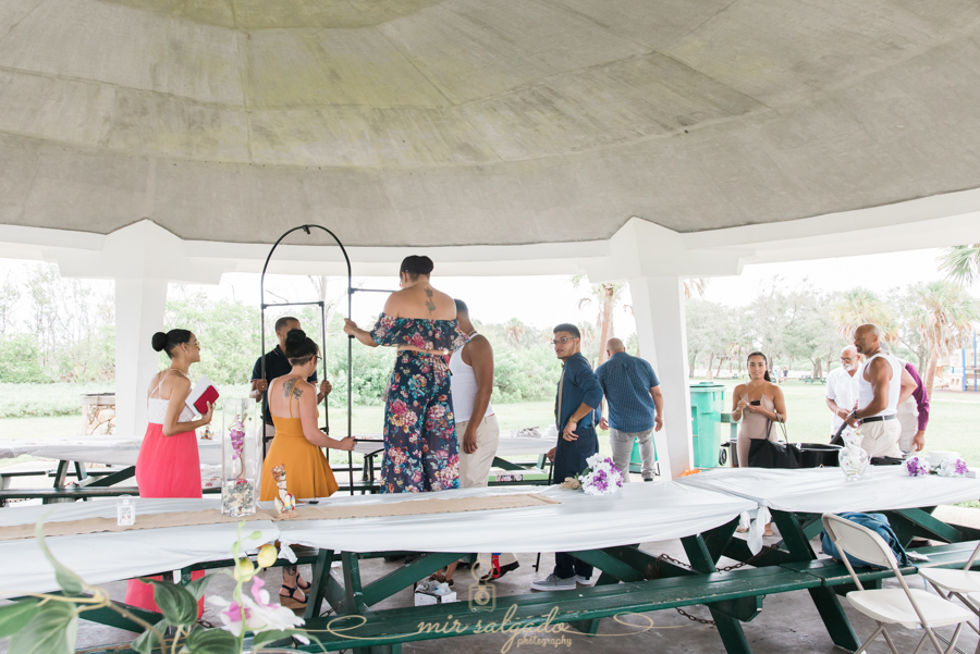 Fort-De-Soto-beach-pictures-flowers-white-table-cloth-green-tables-setting-up