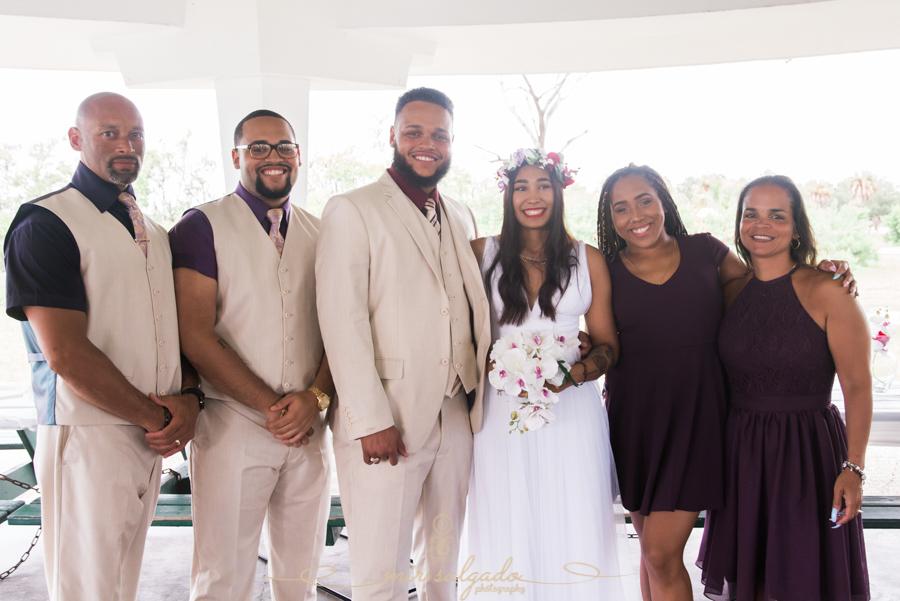 Fort-De-Soto-beach-pictures-flowers-flower-crown-wedding-dress-tan-suit-tampa-photography-bridal-party-bouquet