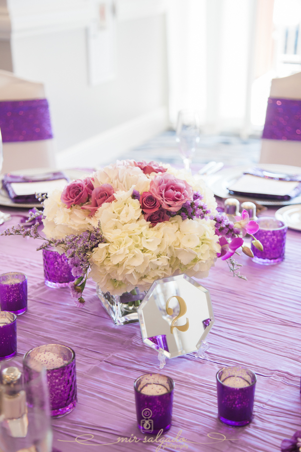flower-table-decoration, purple-candle-holders, table-cloths