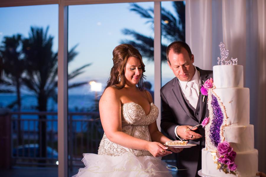 Hyatt-clearwater-beach-resort-spa, Tampa-wedding-photographer, bride-groom-session, bride-groom-cutting-cake
