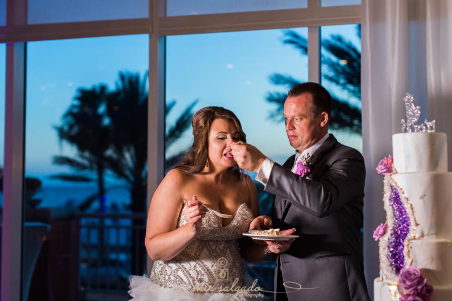 Hyatt-clearwater-beach-resort-spa, Tampa-wedding-photographer, bride-groom-session, bride-groom-cake-cutting