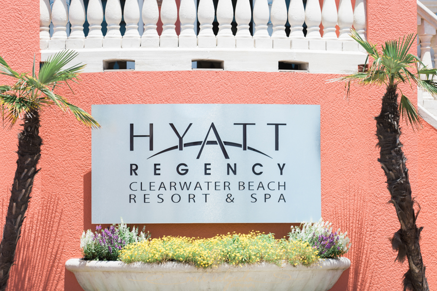 Hyatt-clearwater-beach-resort-spa, Tampa-wedding-photographer, flower-palm-tree-entrance