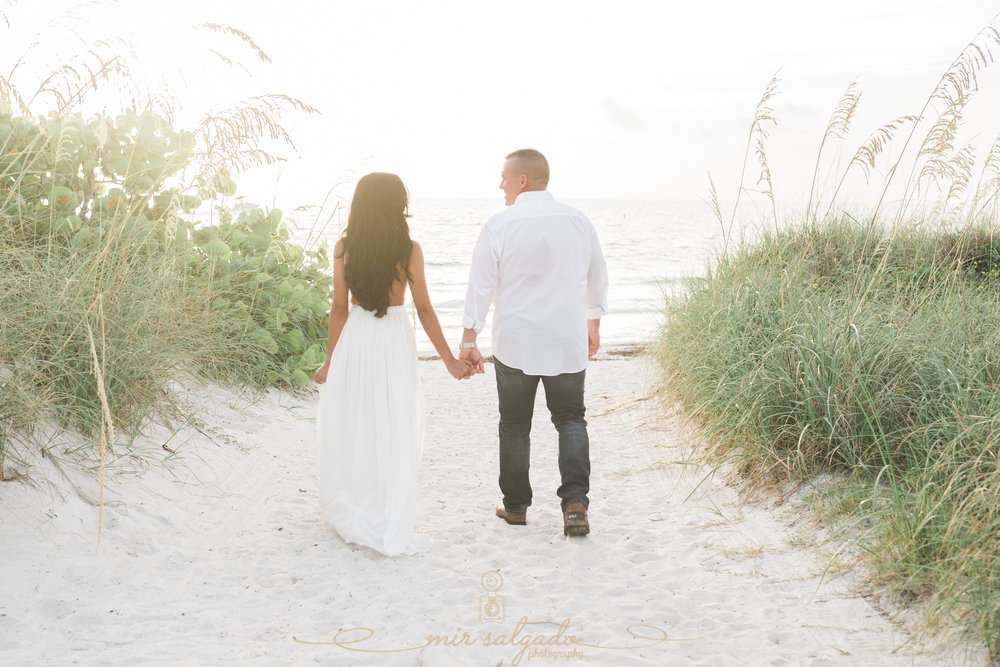 walking-to-sunset-beach-engagement-photos, tampa-beach-engagement-photographer, tampa-wedding-photographer