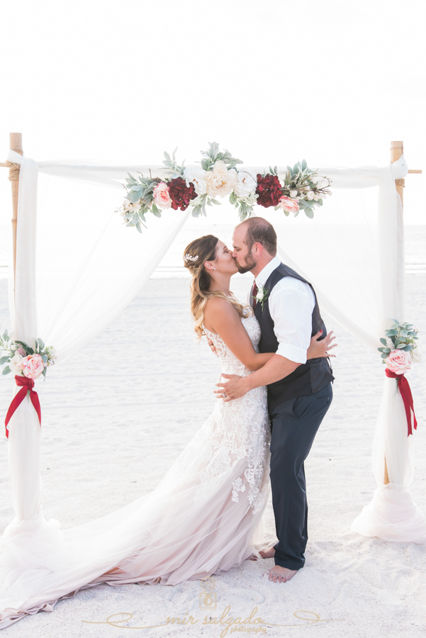 first-kiss-photo, beach-wedding-photo, St.Pete-wedding-photographer