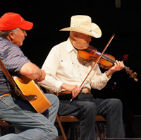 Jim Widner (right) competed in Weiser in the 1950s and 1960s. He brought down the house as a recent guest performer.