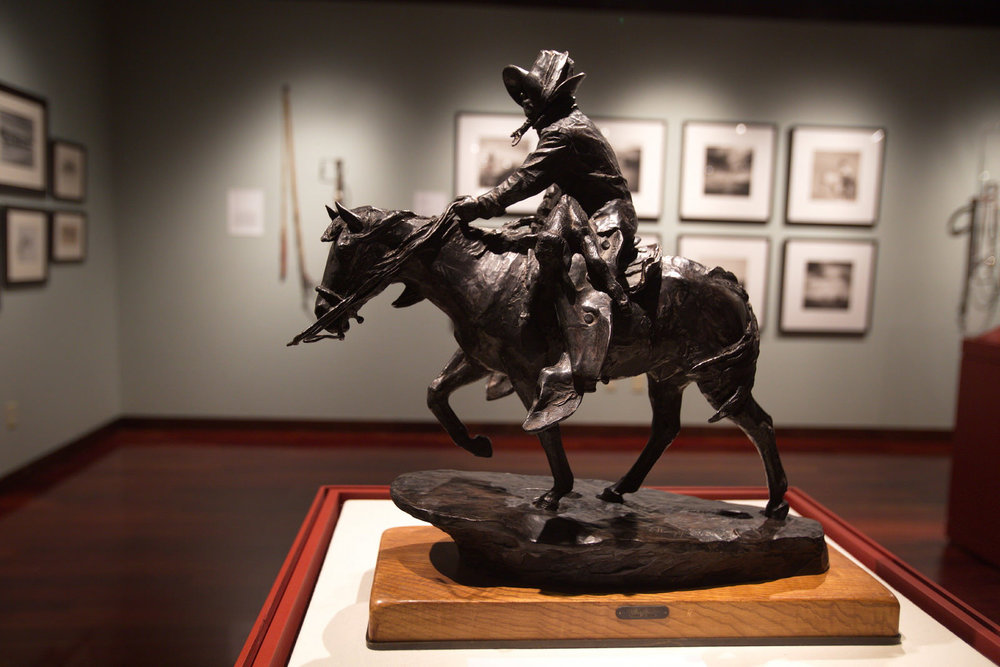 Horses in the American West, a Nevada Museum of Art-Western Folklife Center collaborative exhibition in the Wiegand Gallery. Safe and Sound by Harry Jackson (1982) bronze, collection of Bill Searle. Photo by Charlie Ekburg, 2017 National Cowboy Poetry Gathering.