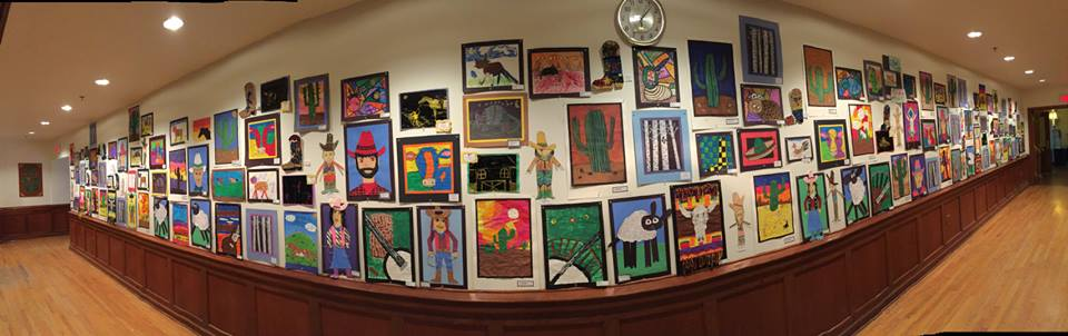 Panoramic photograph of Elko County grade school students' art exhibition in the G Three Bar theater, 2017  National Cowboy Poetry Gathering.