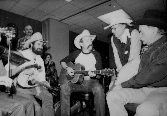 Muzzie Braun, Baxter Black, Ramblin' Jack and Richard Farnsworth jamming upstairs at the Stockmen's in 1987. Photo by Sue Rosoff.