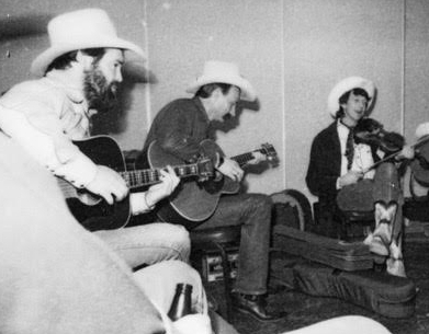 Muzzie Braun, Baxter Black and Woody Paul jamming upstairs at the Stockmen's in 1987. Photo by Sue Rosoff.