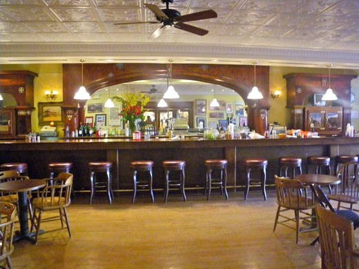 The Pioneer Saloon, with its impressive, 40-foot 1890 Brunswick back bar constructed of mahogany and cherry wood inlaid with mother-of-pearl.