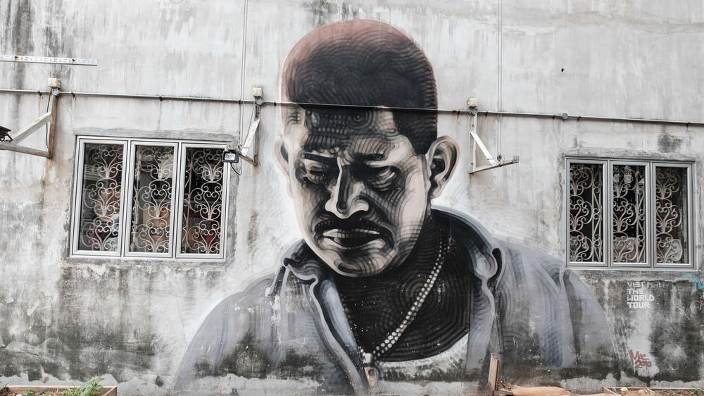Street art by El Mac on the exterior wall of 107/109 Rowell Road (http://elmac.net/)