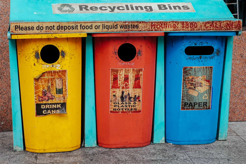 These bins have seen better days. Sadly, a lot of trash - not for recycling - finds its way into these things.