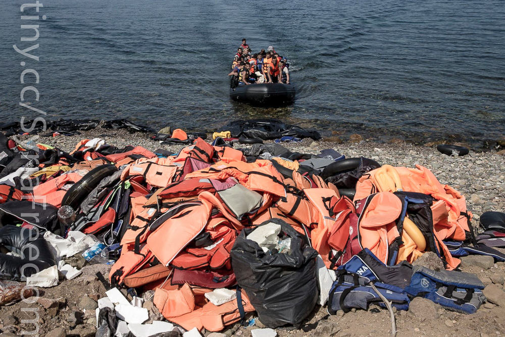 Migrants and refugees arrive by dinghy after crossing from Turkey to the island of Lesbos, Greece.Photograph by Freedom House.
