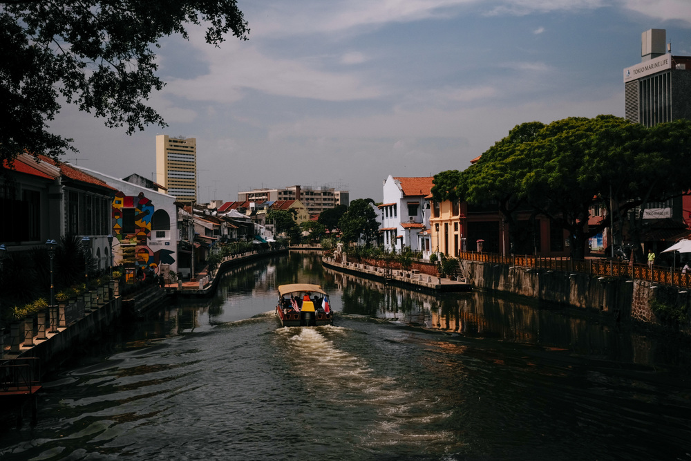 Boating down the Melaka River in gentle evening light
