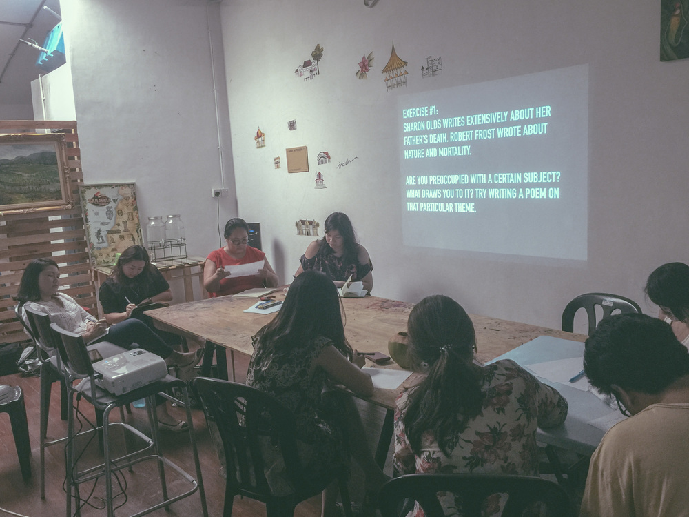 A poetry writing class on the second floor of Indah Cafe