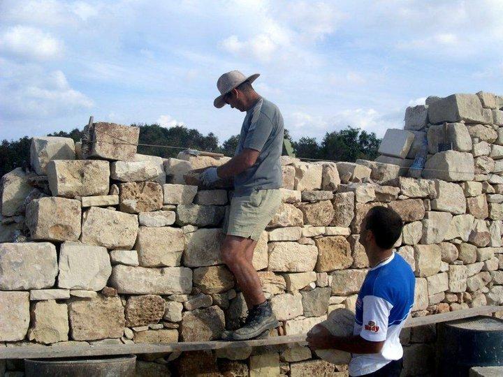 Simon at work rebuilding a boundary wall. Photo courtesy of Simon Buttigieg