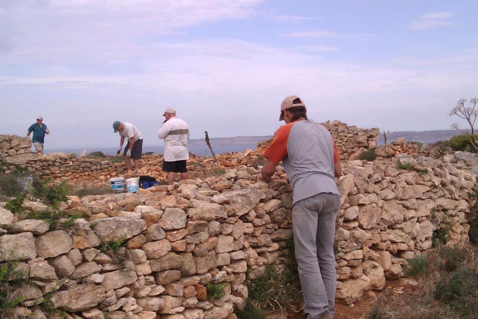 Mending a boundary wall. Photo courtesy of Simon Buttigieg
