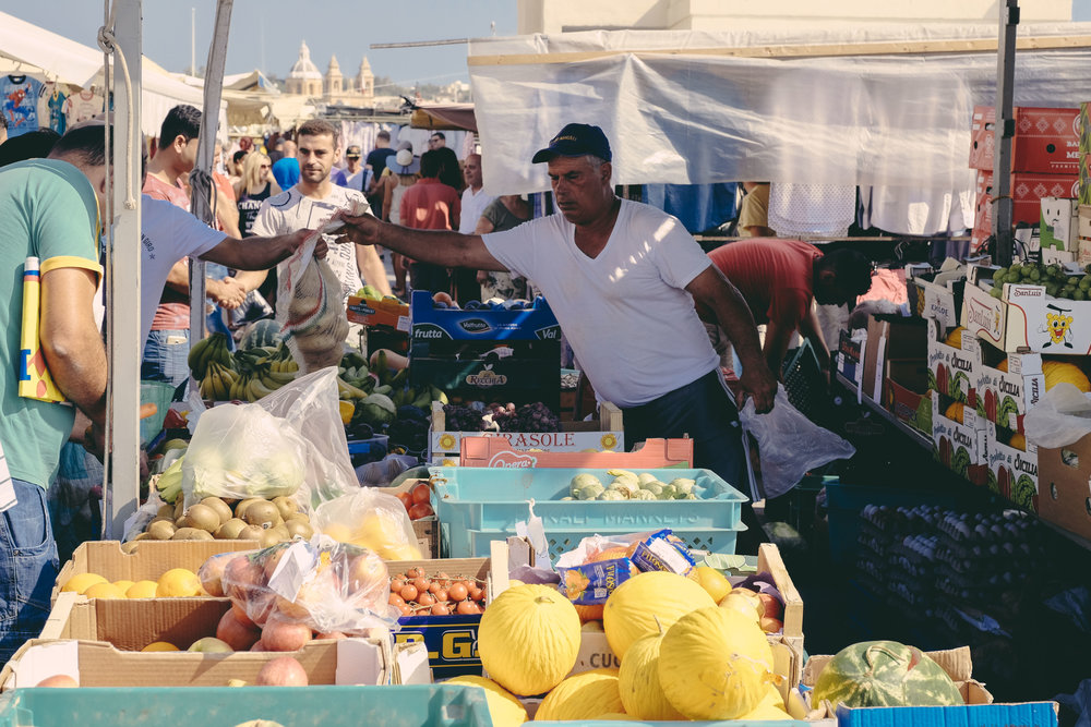Market day at Marsaxlokk. The majority of the crops on sale are grown in Malta.