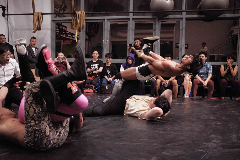 "Photo: Marc Nair - Causeway Jam, 16 March 2018, Grapple MAX dojo. ""We wrestle without a traditional wrestling ring or ropes. This creates an immersive, intimate environment that puts the audience mere feet from the action."""