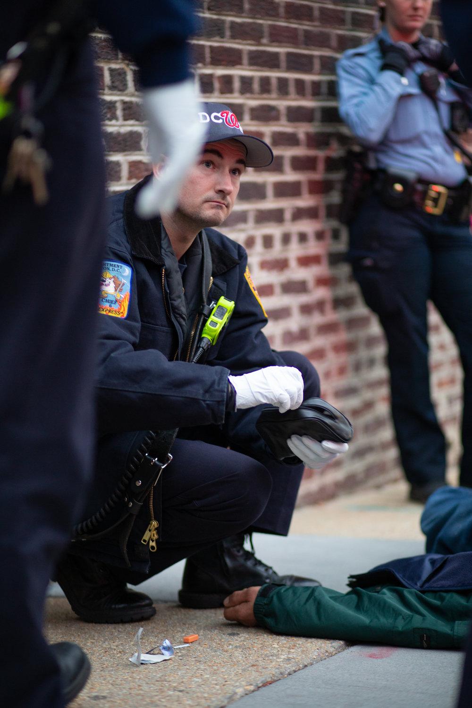 WASHINGTON D.C., April 7th, 2018-- Sergeant Ward assesses an unconscious patient.  Photo by Taylor Mickal.
