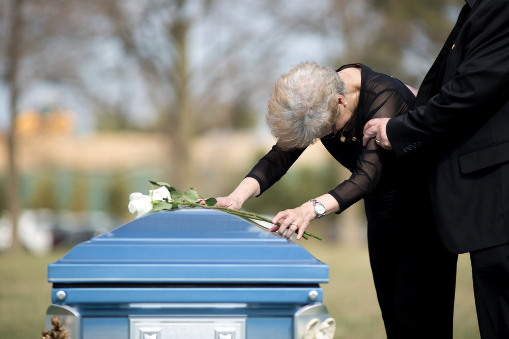 WASHINGTON D.C., March 02, 2018-- A woman grieves over her husband's casket.  Photo by Taylor Mickal
