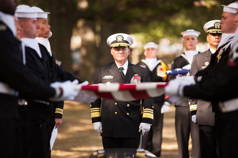 WASHINGTON D.C., October 05, 2017-- The lead Admiral stands at attention as the flag begins to be folded.  Photo by Taylor Mickal