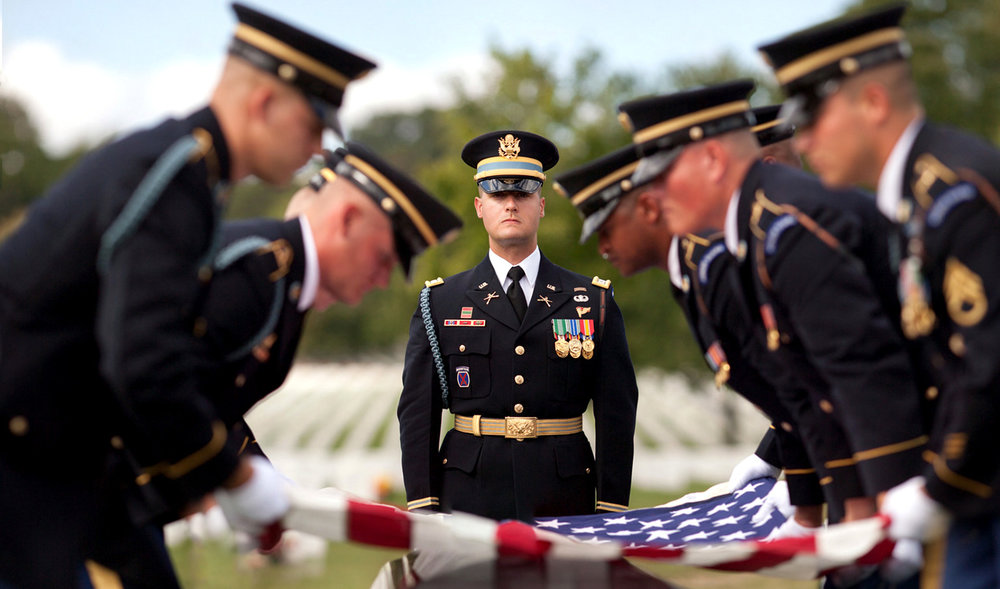 WASHINGTON D.C., September 27, 2017-- A soldier leading the funeral service watches as the detail lifts the flag in preparation for its folding.  Photo by Taylor Mickal