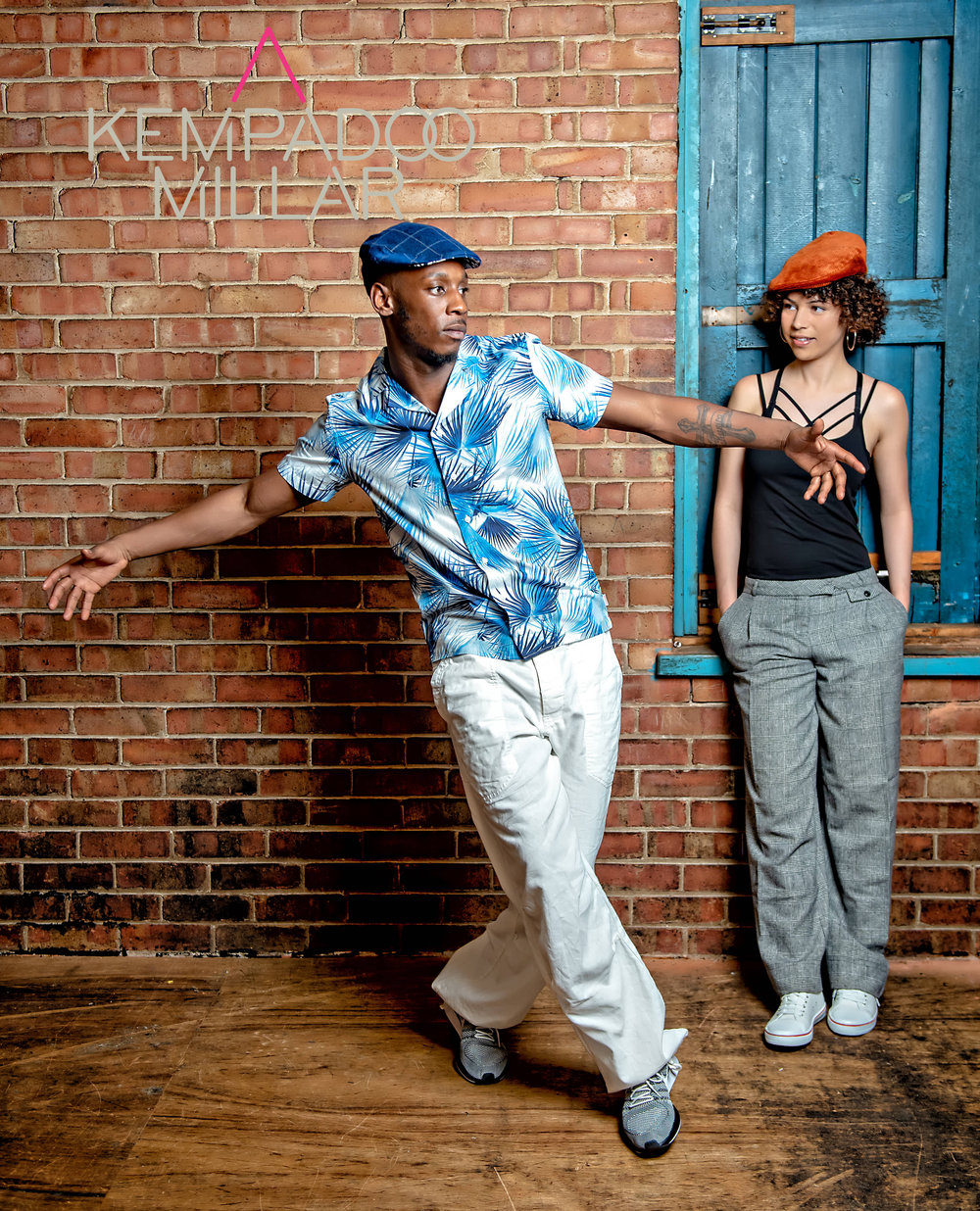 Dancer Jerome Wilks wearing Lisbon Check and Reggaeton Dancer Jasmine Greaves in our Parkin Orange Cord Cap