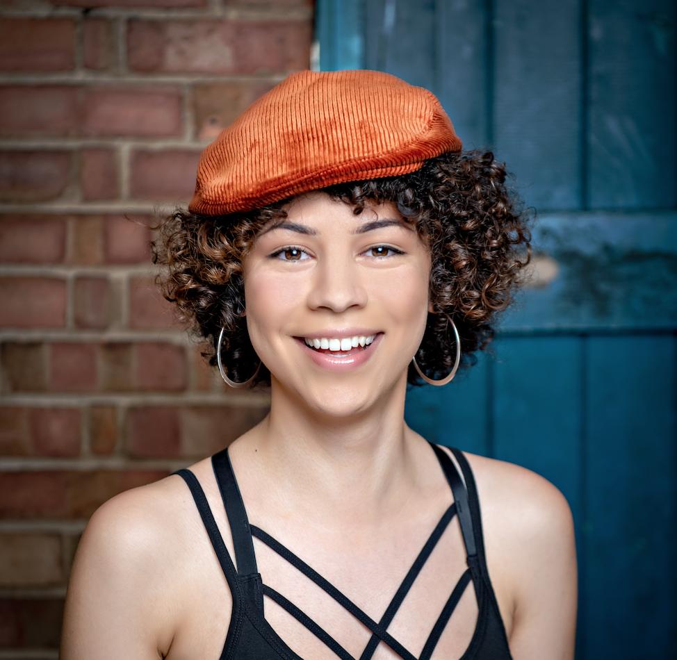 Dancer & artist Jasmine Greaves in our Parkin Orange Cord Cap