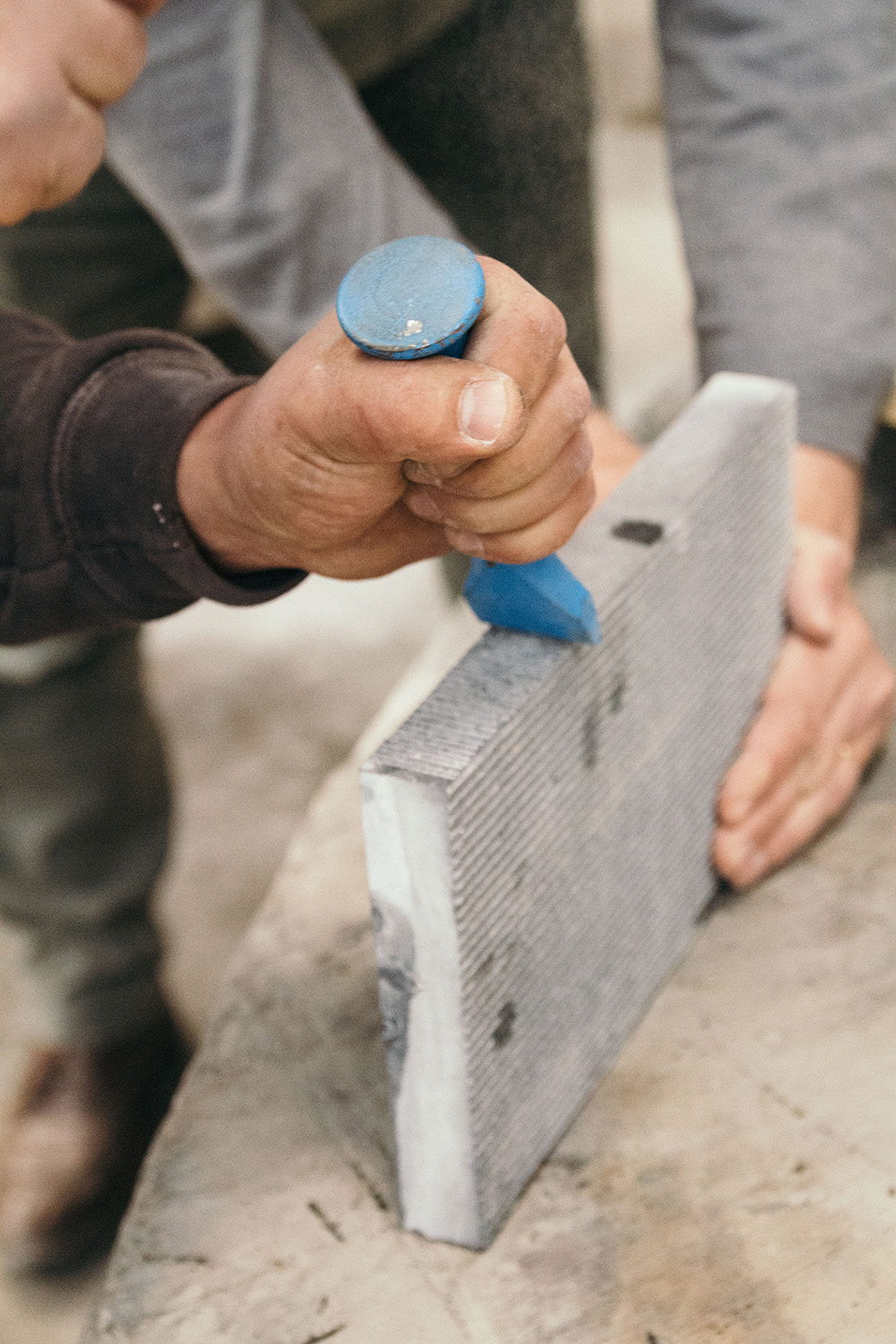 Belgian stone being carved at the marble workshop.