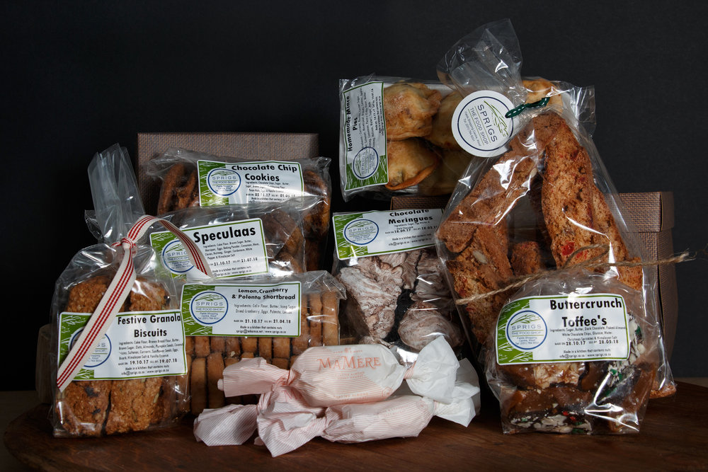4 x Mamere Nougat twists, Christmas Biscotti, Chocolate Chip Cookies, Buttercrunch toffees, Chocolate meringues, Speculaas cookies, Mince Pies, Festive granola cookies and Lemon and cranberry polenta shortbread cookies. R599