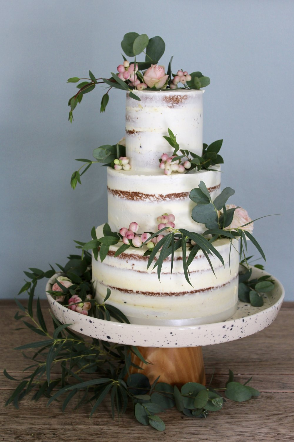 Semi-naked Green and White Wedding Cake by Yolk www.cakesbyyolk.com