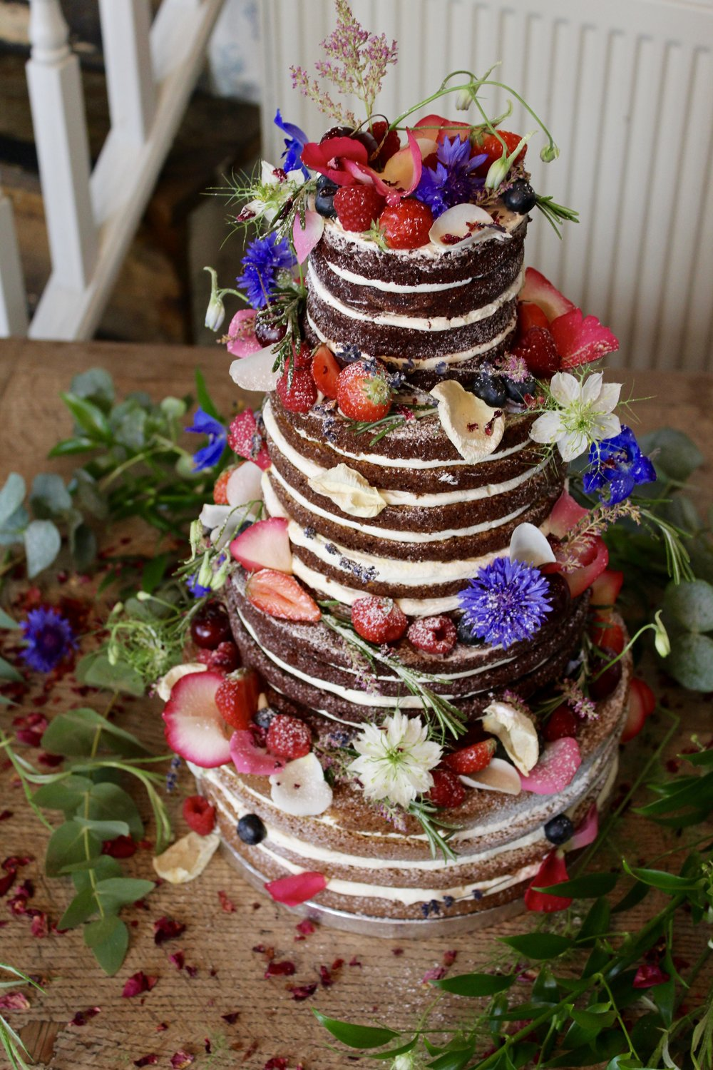 Naked Wedding Cake with fruit and flowers by Yolk.  www.cakesbyyolk.com